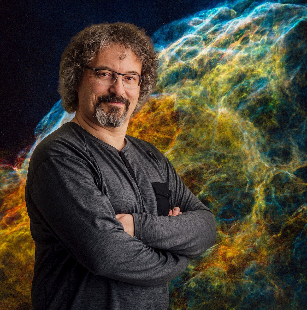 Laurent Drissen in front of an image produced by SITELLE of the supernova remnant IC 443. This image is one of the most spectacular images produced by SITELLE is a good example of the capabilities of the instrument.  Photo credit: NSERC