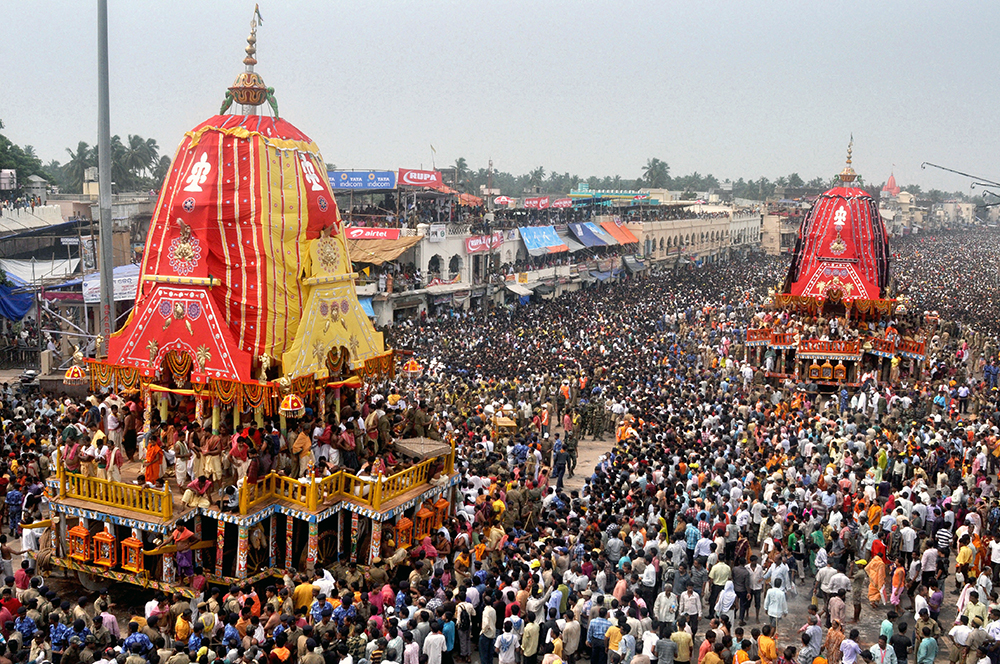 The enormous chariots of Lord Jagganath and his brother, Lord Balabhadra, proceed through the thronging crowd during the annual Rath Yatra, or Festival of Chariots, at the Jagannath Temple complex in Puri.
