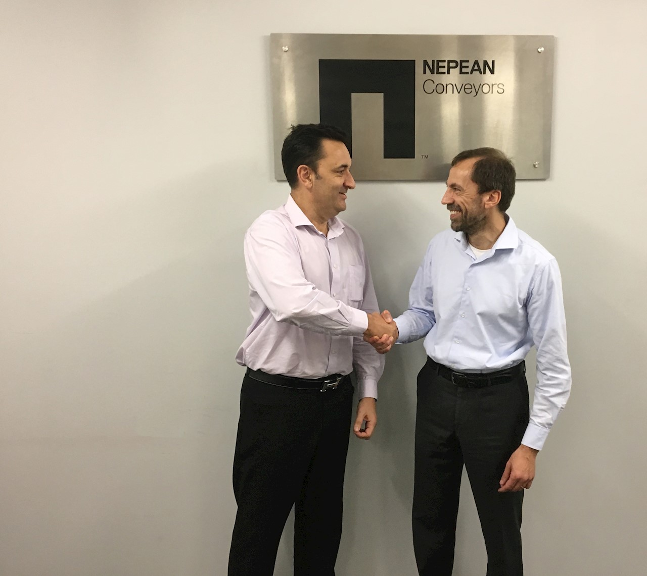 Quintin Roberts, General Manager, NEPEAN Conveyors Queensland (left) and Giovanni Pedrinoni, Local Business Unit Manager, Motors and Generators, ABB in Australia