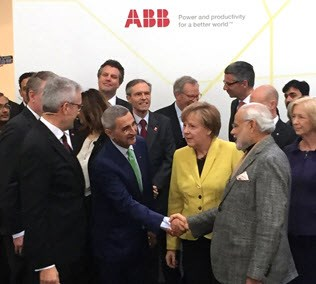 Alongside ABB CEO Ulrich Spiesshofer and German Chancellor Angela Merkel, newly appointed ABB Chief Technology Officer Bazmi Husain shakes hands with India Prime Minister Narendra Modi at this year's Hannover Fair