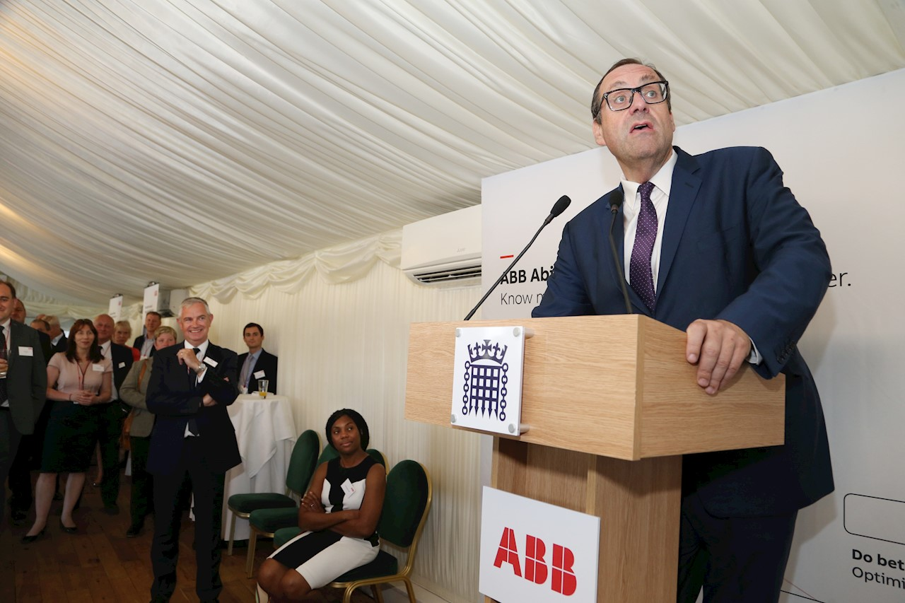 Richard Harrington, Minister for business and industry at the Department for Business, Energy and Industrial Strategy speaking at the reception, with Kemi Badenoch seated to his right and Ian Funnell, Country MD standing to her right