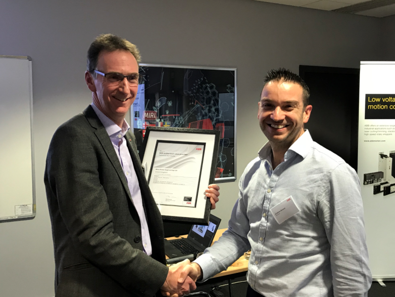 (L to R) Peter Myatt, ABB Channel Manager – Drives congratulates Beta Power's managing director Andrew Brown