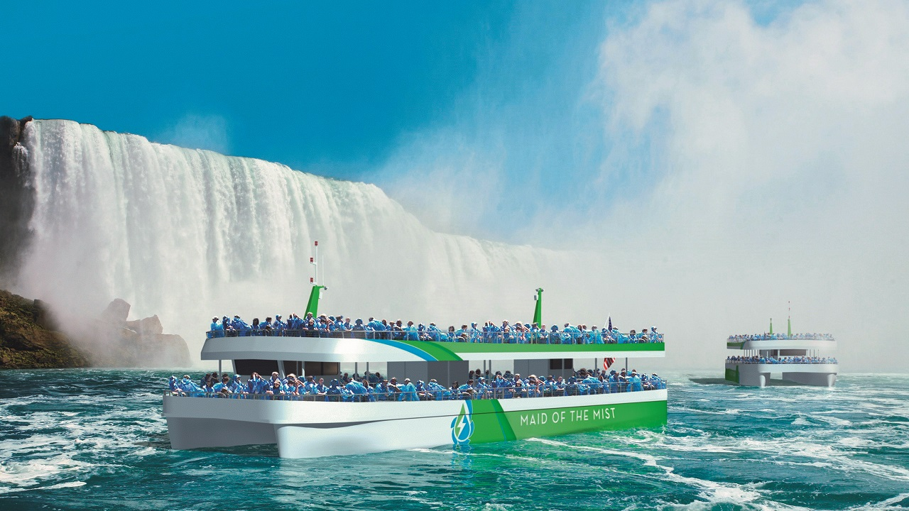 01 Artist's rendering of the two new all-electric Maid of the Mist tour boats. The boats' design is modular. The modules were built in a shipyard then trucked to site, where they were craned into the assembly area near the river. Craning the vessel modules to the assembly area was challenging due to the difficult topography of the area. The boats' hulls are made from 5086 H116 marine-grade corrosion-resistant aluminum alloy.