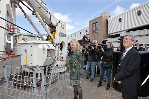 Port of Hoek van Holland, Netherlands: Melani Schultz van Haegen, Minister of Infrastructure and the Environment, activates the crane to plug in the power cable into the ship. On the right far side, Pim de Lange, Managing Director of Stena Line Netherlands.