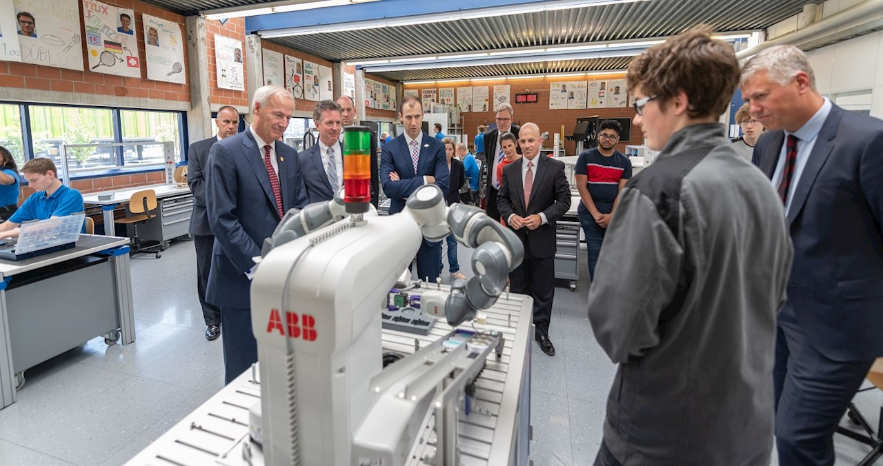 Apprentices work with ABB's collaborative robot, YuMi
