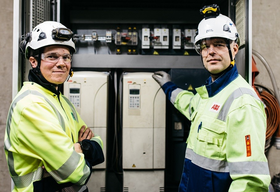 """ABB's drives control the electric motors of various conveyors and separators in the Lassila & Tikanoja recycling facility. Esa Ekola of Lassila & Tikanoja (left) tells ABB's Janne Sutinen that he is pleased with the reliability of the availability stock service and the facilitation of maintenance by ABB. """"With ABB's service, we always get the latest equipment quickly deployed if needed."""""""