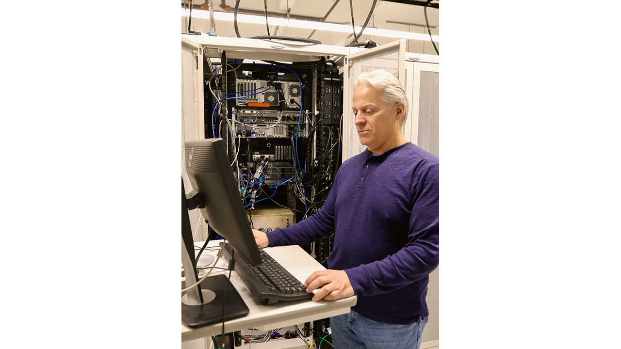 02c ABB's automation solution permits the college to track the inventory of all data center racks (shown here with Levine); this allows them to easily predict how additions and changes will impact the system.