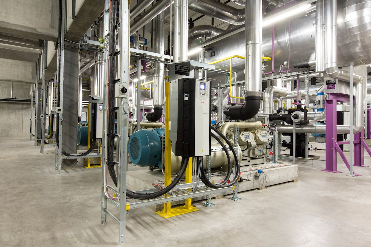 Utilizing high efficiency motor and drive technology saves energy in refrigeration systems typically found deep in the center of a food and beverage facilities.